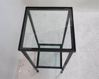 2 tier iron and glass stand. chip on lower glass.  PIC 2