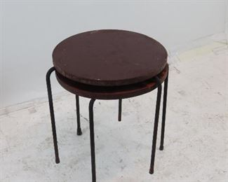 ITEM 192 ---pair MCM wood top nesting tables with iron tripod legs. need refinishing. [underneath missing original screw and spacer, top split and glued].  $100.00
