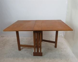 """ITEM 209---MCM dropleaf folding table. Has some chips, veneer loss, scratches.  36"""" x open 54"""" , 2-23.5"""" leaves, 7' center, closed--36"""" deep, 9"""" wide, $225.00"""