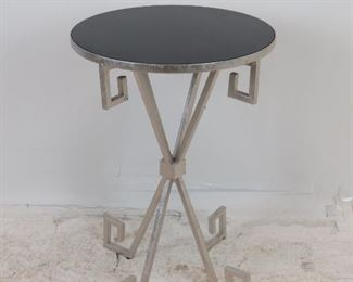 """ITEM 218 --- contemporary silvered metal table with black acrylic top. 18"""" diameter, 26.25"""" high  $50.00"""