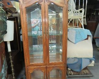"""ITEM 224--- Carved french beveled glass curio cabinet with lights and mirrored back. 34"""" wide, 15"""" deep, 80"""" high. 3 adjustable shelves on top [no bottom glass shelf].  $275.00"""