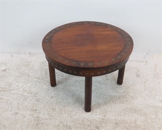 """ITEM 228--- Rosewood brass inlaid table. surface imperfections. 24.75"""" diameter, 16"""" high. $60.00"""