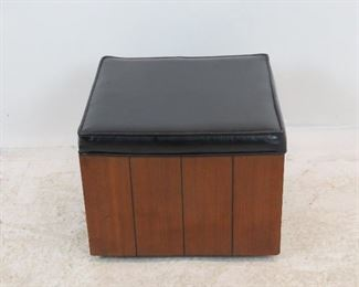 """ITEM 230-- MCM wood and vinyl ottoman on wheels. 16"""" square, 12.5"""" high. $50.00"""