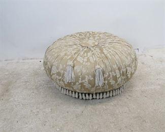 "ITEM 249--- upholstered pleated ottoman on legs, missing a couple tassels. 36"" diameter, 16"" high.  $75.00"