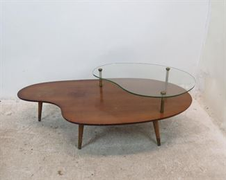 """ITEM 259--- MCM boomerang style coffee table, chips on glass, surface marks, stains.  51"""" long, 27.25"""" wide. 16.75"""" high $75.00"""