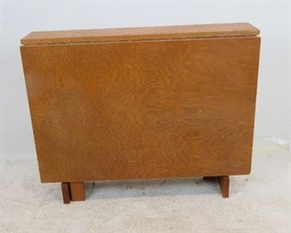 MCM dropleaf folding table. Has some chips, veneer loss, scratches.  PIC 2