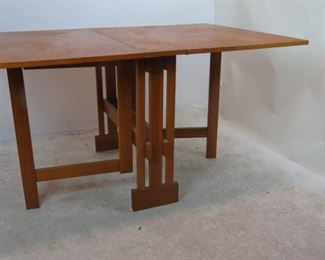 MCM dropleaf folding table. Has some chips, veneer loss, scratches. PIC 5