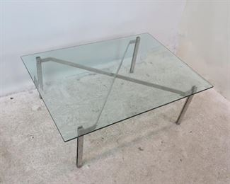 """ITEM 10 --High quality Steel and beveled glass coffee table. 48"""" long, 36""""wide,  16 3/4"""" high  $450.00"""