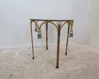 Item 287-- Hollywood Regency iron and glass top table with tassel and leaf design. [paint discoloration]. PIC 3