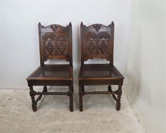 """ITEM-358-- Pair of Carved Jacobean oak cane seat chairs. chip missing on runner, roughness and chips . 20.5"""" wide, 20"""" deep, 40.5"""" high,  height to seat 18.25  $150.00"""