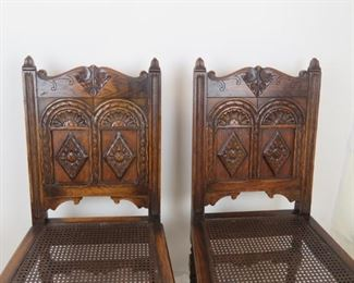ITEM-358-- Pair of Carved Jacobean oak cane seat chairs. chip missing on runner, roughness and chips  PIC 2