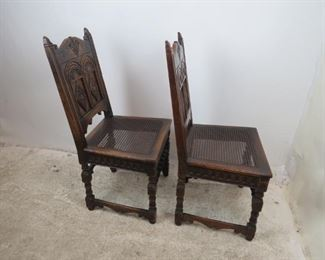 ITEM-358-- Pair of Carved Jacobean oak cane seat chairs. chip missing on runner, roughness and chips   PIC 4