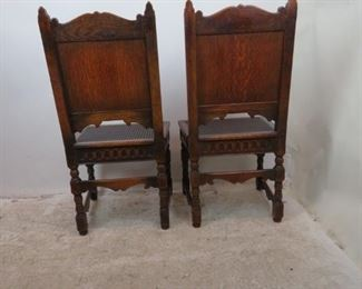 ITEM-358-- Pair of Carved Jacobean oak cane seat chairs. chip missing on runner, roughness and chips   PIC 5