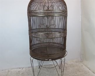 """ITEM--371-- 2 part  Large contemporary metal bird cage on -stand.  Base, 23.25"""" high, 35"""" diameter, top 55"""" high, total height on stand-78"""".  $250.00"""