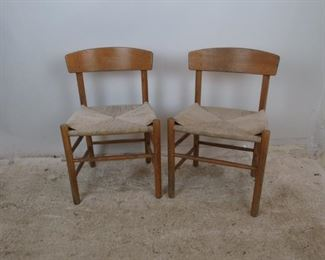 """ITEM- 378 - pair of MCM oak chairs with woven rope seats. finish is worn. 9"""" wide, 15.5"""" deep, 29.75"""" high, 17""""high to seat.  $350.00"""