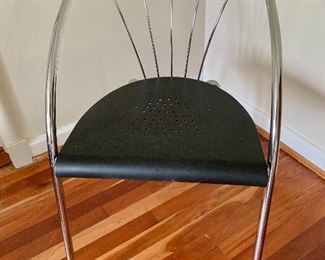 """$75 Contemporary metal side chair 31"""" high by `9"""" wide"""