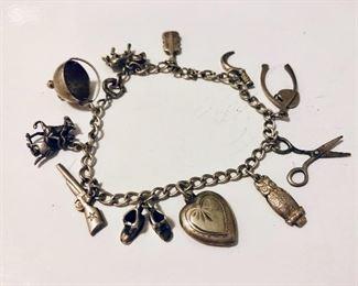 $30 Vintage silver tone charm bracelet