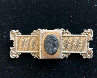 $40 Vintage intaglio gold tone pin