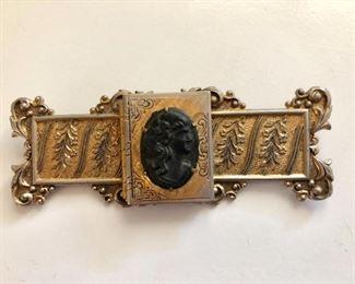 Detail vintage intaglio gold tone pin