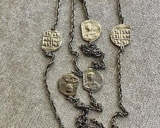 $25 Silvertone coin medallion shaped necklace
