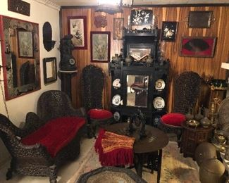 Antique Anglo Indian (Burmese) intricately carved settee, 2 highback chairs, lounge chair.  Antique Eastlake mirrored etagere display cabinet