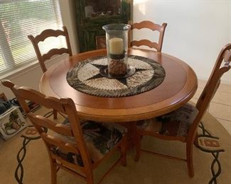 $650- Fabulous Round solid wood table and four chairs