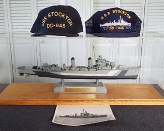 USS Stockton model, photo, and caps