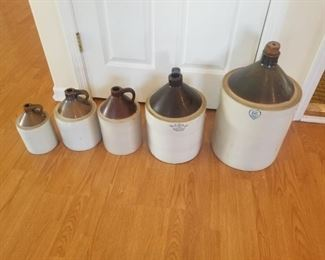 Matched set of various sized crocks.