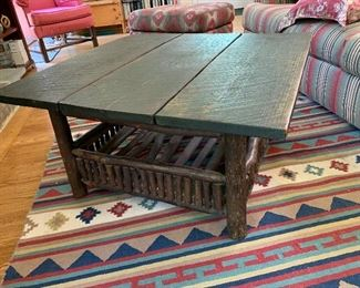 """$250 Rustic coffee table with tree branch detail; @ 33"""" each side and 17"""" high"""