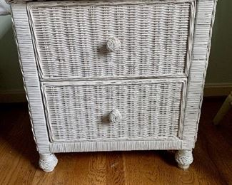 """$120 for pair. Two matching wicker end tables, minor areas of chipped paint. 21"""" W, 22.5"""" H, 17.5"""" D."""