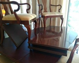 """8 chairs, w/2 captain. All custom pads. 3 leaves extend to 126"""" excellent condition."""