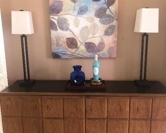 Mid-Century sideboard with a black top -  $750 and a pair of iron lamps $200