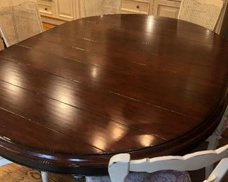 "60"" Round Cherry Wood Kitchen table with an additional 22"" leaf (shown) - base is hand-painted $1500"