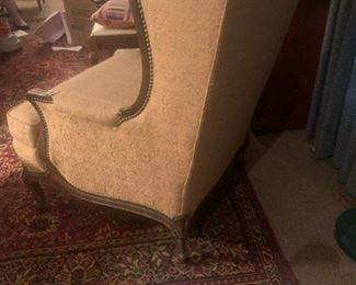 Reading chair with original blemish-free upholstery.