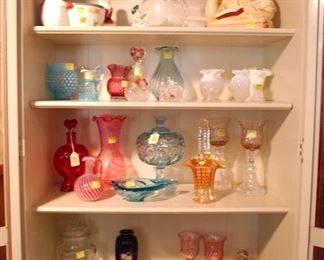 Various glass pieces in a curio cabinet