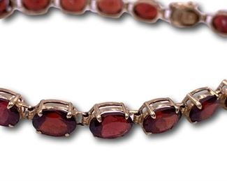14K gold garnet bracelet. Bidding ends at 3 p.m. on 7-20-2020.  Register at https://auctions.mlestatesales.com.  Don't forget to check out our other auctions too!