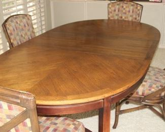 Dining table 4 chairs/leaves and pads.