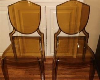 Two Lucite chairs