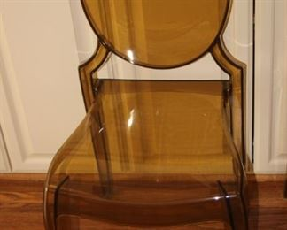 One of two Lucite chairs.