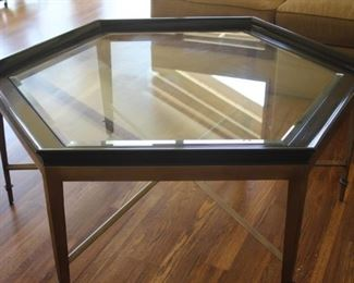Six sided glass and wood Asian themed coffee table.