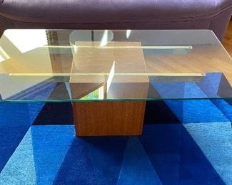 20% off of $295 Mid-century modern glass top coffee table on wood block base with brass supports