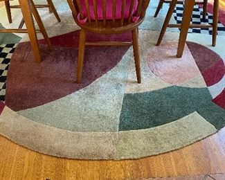 20% off of $75 Round multi-color rug
