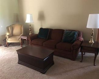 Nice clean couches, coffee table, wingback chairs and end tables!