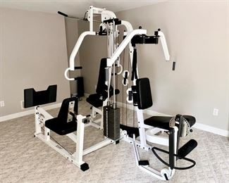 Home gym fitness center weight machine with leg attachments