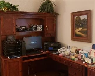 Office desk, office supplies, books, floor lamps