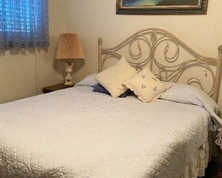Full Size Bed with Wrought Iron Headboard,  Antique Lamp