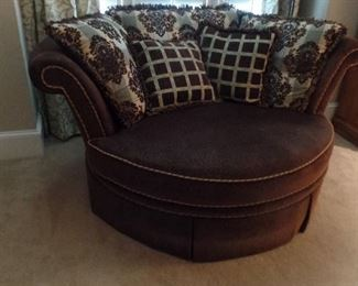 over size circular upholstered chair with pillows $450