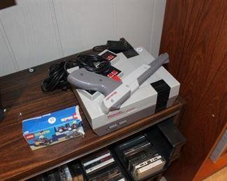Vintage Nintendo Entertainment System w/ controllers, light gun
