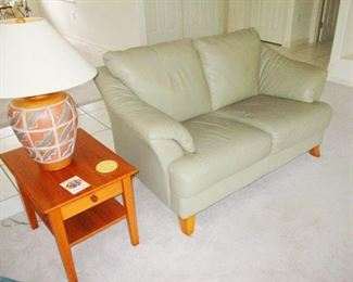White/Silver Leather love seat with teak feet. Teak lamp table