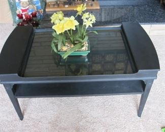 Painted black coffee table with lift top compartments on each end